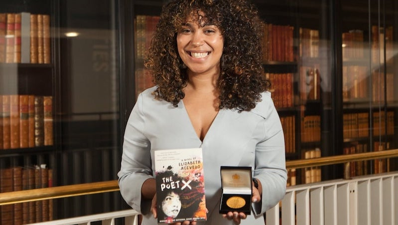 "A photo of Elizabeth Acevedo and her best selling novel ""The Poet X"" along with the Carnegie medal"
