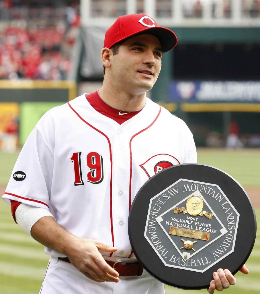 A photo of Joey Votto holding the 2010 MVP award he received playing for the Cincinnati Reds