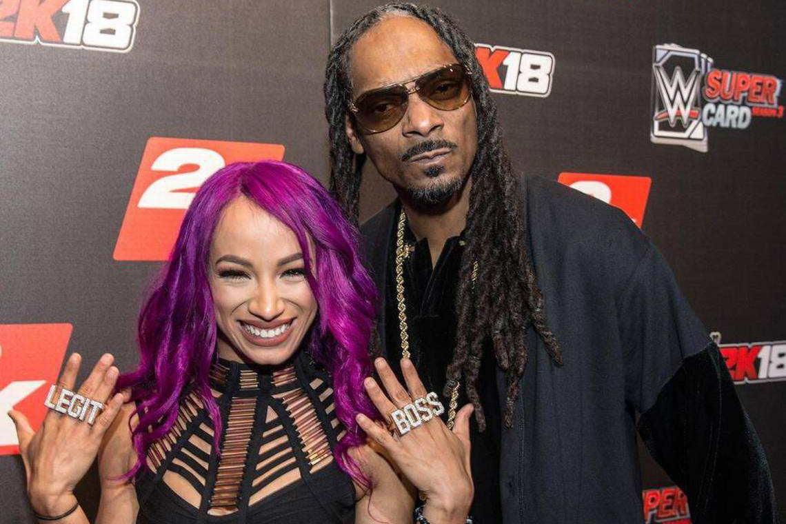 A photo of Sasha Banks with Snoop Dogg